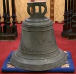 Bell from Santiago church during return ceremony at St. Thomas's in Neath, Wales