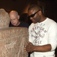Musician Blessing Offor, blind from birth, touches sphinx during September 24th special session