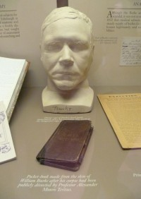 Death mask and a pocketbook made from the skin of executed serial murderer/resurrection man Burke