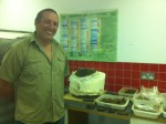 Metal detectorist Ken Rive with his find behind him in the Jersey Heritage conservation laboratory