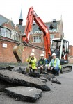 Diggers removing the tarmac from the parking lot for the first trench - University of Leicester