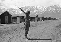 American soldier guards Japanese internment camp at Tule Lake, CA