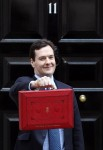 Chancellor of the Exchequer George Osborne holds up his red ministerial box outside 11 Downing Street