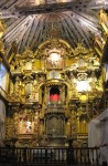 San Pedro's gilded altarpiece, solar lamb at the top
