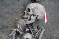 Skeleton holding a ceramic bowl