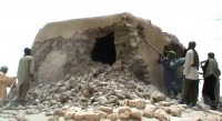 Still from video showing Ansar Dine extremists destroying a Sufi shrine in Timbuktu on July 1st, 2012