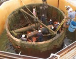 Dahlgren guns in upside-down turret inside the coffer dam when they were raised in 2002. Photo courtesy the Mariners' Museum.