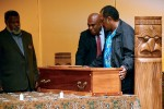 Chief of La Foa district Bergé Kawa (middle) receives his ancestor's remains