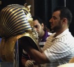 Jacqueline Rodriguez's photograph of man gluing the beard on Tut's funerary mask on August 12th, 2014