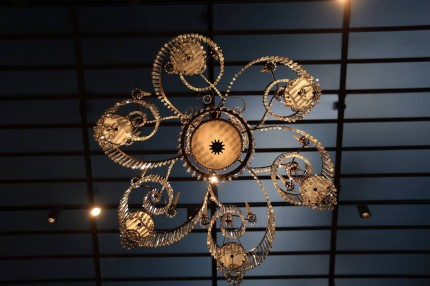 Spiral chandelier hanging in Gallery 31, seen from below with gallery lights shining through it