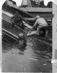 Diver and other rescue workers recover victim of Eastland disaster. Photo by Jun Fujita.