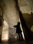Visitor looks up at the vaulted ceiling above the apse. Image by Filippo Monteforte/AFP.