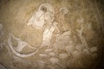 Stucco decoration depicting Sappho as she steps off the cliff into the ocean. Image by Filippo Monteforte/AFP.