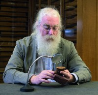 Dr. Irving Finkel examines Atra-Hasis Ark Tablet in the British Museum. Image by Dale Cherry.