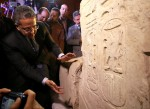 Egyptian Minister of Antiquities Khaled El-Enany stands beside the colossus explaining new evidence pointing to it depicting Psamtek I in Cairo. Photo by Mohamed Abd El Ghany/Reuters.