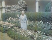 Still of First Lady Lou Hoover in the White House garden. Photo courtesy Herbert Hoover Presidential Library-Museum.