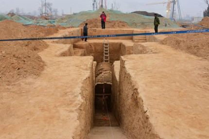 Excavation of ancient burial chamber. Photo by Li Sixin, Imagine China.