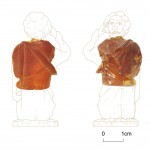 Amber carving with drawing of complete figure. Photo © Northern Archaeological Associates.