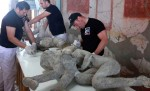 "Conservators work on ""Two Maidens."" Photo courtesy the Archeological Site of Pompeii."