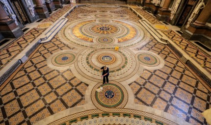 Ann Lawton, a cleaner at Liverpool's St George's Hall, cleans the Minton Tiled Floor now on display. Photo by Peter Byrne.