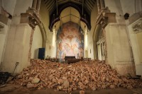 Mural reappears behind piles of brick from demolished wall. Photo courtesy the Coventry Telegraph.