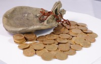 Suede drawstring pouch and coins from the hoard. © Portable Antiquities Scheme/The Trustees of the British Museum. Photo: Peter Reavill.