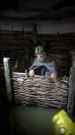 New recreation of Viking latrine being flushed. Photo by Anthony Chappel-Ross courtesy the Jorvik Viking Centre.