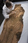 Shroud undergoes conservation. Copyright National Museums Scotland.