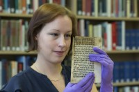 Erika Delbecque with the Caxton leaf. Photo courtesy the University of Reading.