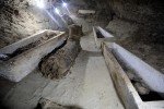 Limestone coffins and mummies inside burial site. Photo by REUTERS/Mohamed Abd El Ghany.