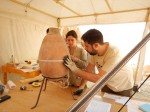 Middle Kingdom Theban Project team examines amphora. Photo courtesy the Middle Kingdom Theban Project.
