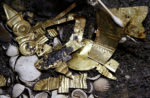 Detail of 22 gold pieces formed into symbols in wolf burial. Photo by REUTERS/Henry Romero.
