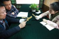 Archaeologists examine Quin wood slips. Photo courtesy Xinhua.