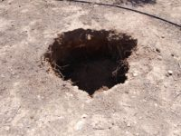 The pit that opened up under the truck. Photo courtesy the Lassithi Ephorate of Antiquities.