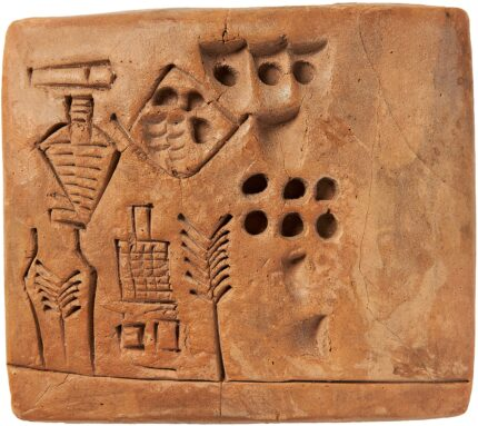 The Kushim Tablet, baked clay, pictographic script Uruk III, ca. 3100 B.C. Photo courtesy Bloomsbury Auctions.