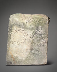 Carved and inscribed slab from 2nd century A.D. used as horse mounting block. Photo courtesy Woolley and Wallis.